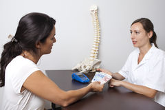 Paying for medical treatment. Patient paying for medical treatment cash royalty free stock photos