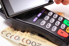 Paying with NFC technology on mobile phone Stock Photos