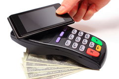 Paying with NFC technology on mobile phone Royalty Free Stock Photography