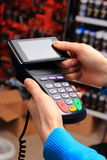 Paying with NFC technology on mobile phone Royalty Free Stock Photos