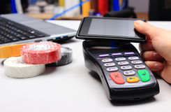 Paying with NFC technology on mobile phone Royalty Free Stock Image