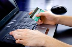 Paying online. With credit card stock image