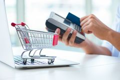 The paying for online purchase with credit at pos. Paying for online purchase with credit at POS stock images