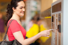 Paying parking fee. Young woman paying parking fee at pay station stock image