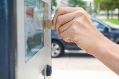 Paying for parking. Man hand paying for parking with a debit card Stock Photography
