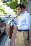 Paying the parking meter royalty free stock image