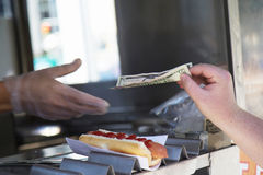 Paying for purchased hot dog Royalty Free Stock Images