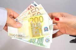 Paying and receiving the money. Image of paying and receiving money currency is euro Royalty Free Stock Photography