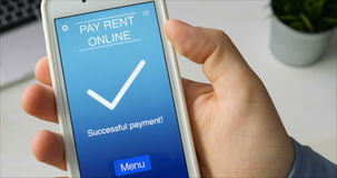 Paying for rent online using smartphone app stock footage