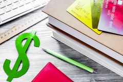 Paying for studing concept with dollar sign and cards on light t stock photos