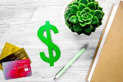 Paying for studing concept with dollar sign and cards on light t royalty free stock photos