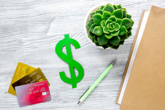 Paying for studing concept with dollar sign and cards on light table background top view Royalty Free Stock Image
