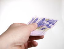 Paying with Swedish money. A hand paying with Swedish money Royalty Free Stock Photo