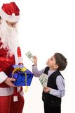 Paying to Santa Royalty Free Stock Photo
