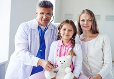 Paying visit to doctor Stock Images