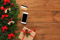 Paying for xmas gifts with smartphone background royalty free stock image