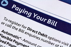 Paying Your Bill. A macro image of an account bill stock photos