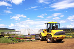 Payloader Utilized For Heavy Lifting At Commercial Horticultural. Nursery Stock Photography