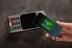 Payment accepted with mobile phone. Payment accepted on terminal with mobile phonen royalty free stock photography