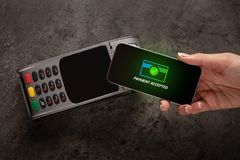 Payment accepted with mobile phone. Payment accepted on terminal with mobile phonen royalty free stock photo