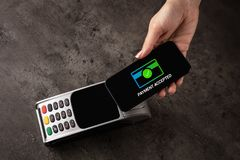 Payment accepted with mobile phone. Payment accepted on terminal with mobile phonen stock photo