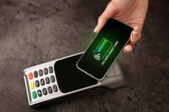 Payment accepted with mobile phone. Payment accepted on terminal with mobile phone stock photos