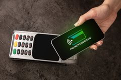 Payment accepted with mobile phone. Payment accepted on terminal with mobile phone royalty free stock photo