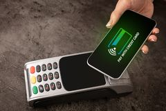 Payment accepted with mobile phone. Payment accepted on terminal with mobile phonen stock photography
