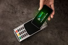 Payment accepted with mobile phone. Payment accepted on terminal with mobile phonen royalty free stock photos