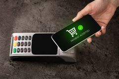 Payment accepted on terminal. Mobile payment accepted on terminal stock image