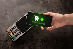 Payment accepted on terminal. Mobile payment accepted on terminaln stock images