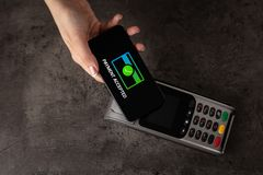 Payment accepted with mobile phone stock photography