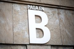 Payment in B black money in Spanish. royalty free stock photo