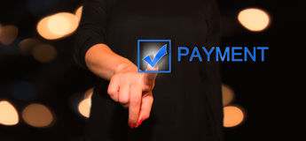 Payment button. Woman clicked the payment button on the interface stock photo