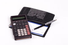 Payment Calculation. A calculator and a cheque/check book Stock Images