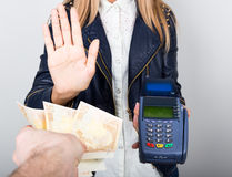 Payment card in a bank terminal. The concept of of electronic payment. woman in one hand holds payment terminal other is Royalty Free Stock Photos