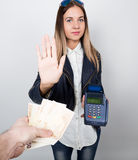 Payment card in a bank terminal. The concept of of electronic payment. woman in one hand holds payment terminal other is Royalty Free Stock Images