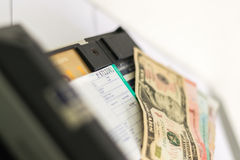 Payment with card, cash. Payment with credit card and cash, card recording machine Stock Images