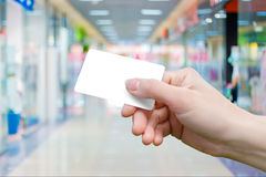 Payment card in hand . Payment card in hand on the background of the store Royalty Free Stock Photos