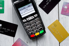 Payment card through terminal in store top view wooden background Stock Images