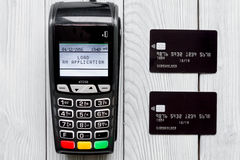 Payment card through terminal in store top view wooden background Stock Photos