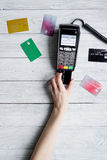 Payment card through terminal in store top view wooden background Royalty Free Stock Images