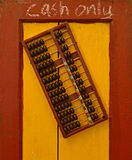 Payment by Cash only. Indicated with writing and traditional wooden abacus Royalty Free Stock Photography