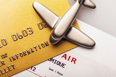 Payment by Credit Card for Airline Tickets. Credit card banking finance shopping close-up gold card airline ticket stock images