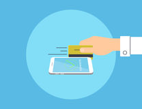 Payment by credit card linked to the smartphone Stock Image