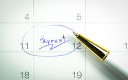 Payment day. And pen on calendar Stock Image
