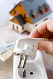 Payment for electricity in house - energy supply and power outlet. Economy and finance - savings Stock Images