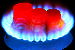Payment for gas. Money and gas torch Royalty Free Stock Images