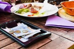 Payment lunch. Payment lunch at the restaurant Royalty Free Stock Photography