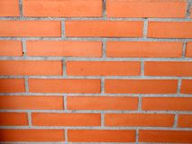 Payment Management Orange red brick wall texture. Building stock photography